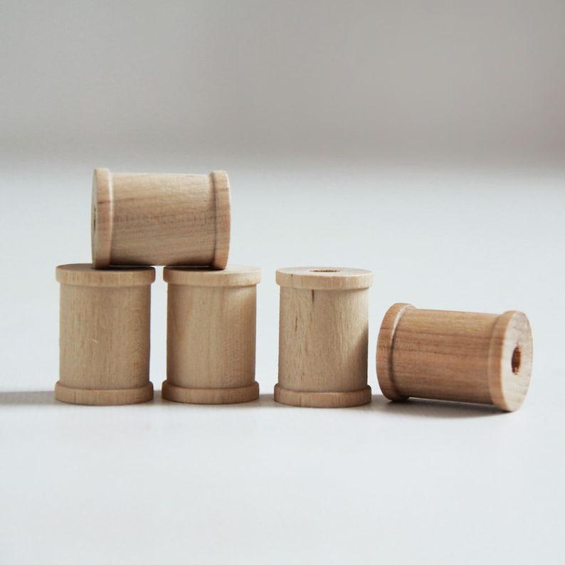 15 Natural Wooden Spools 1 x 3/4 image 1