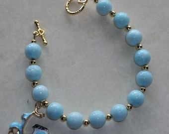 Light blue/Aqua Beaded Coral Necklace with Scooter charm