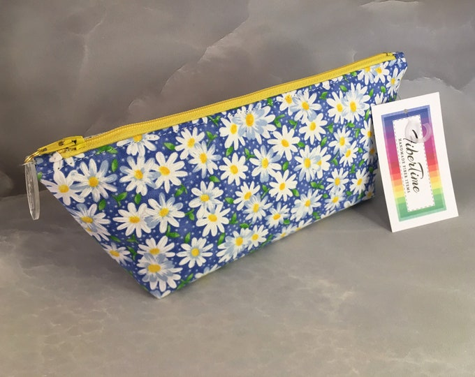 White and Yellow Daisies On Blue Makeup Bag