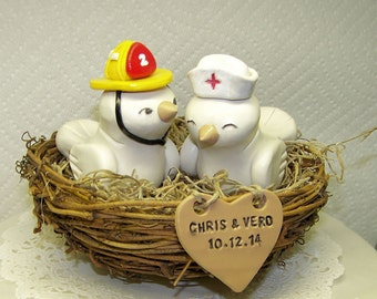 Firefighter and Nurse Wedding Cake Topper Nuzzling in Nest with Heart Sign - Love Birds Cake Topper- Customizable