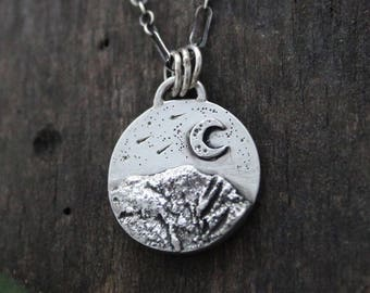 Mountain range under a shooting star night sky, sterling silver 925, wilderness, night sky, mountain range.