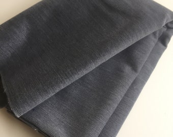 47 inch wide Medium Grey Fabric yardage. 1 1/2 yards Skirt/trousers/jacket weight.