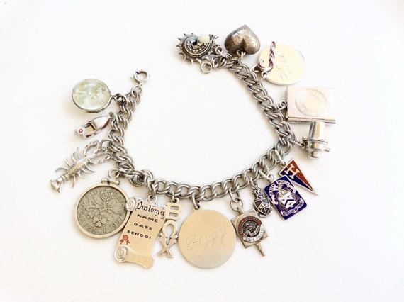 vintage Sterling silver charm bracelet loaded  wit