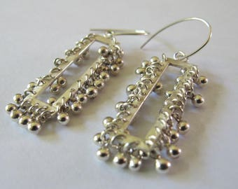 Handmade sterling silver kinetic earrings. Statement earrings.