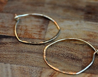 solid 10k gold hoop earrings. Handmade hammered hoop earrings. Petite yellow gold earrings.