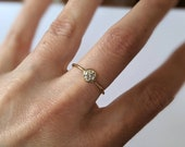 Handmade diamond solitaire engagement ring with solid 14k yellow gold.