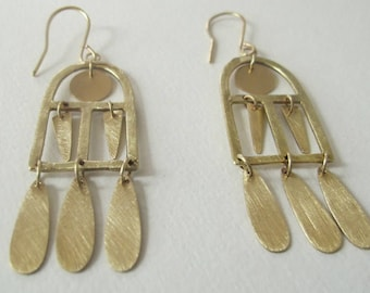 kinetic brass window earrings. Mobile earrings. movement earrings. Dangle and drop earrings. Statement earrings. Free shipping!