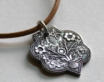 Gandhara Collection on Etsy -  Fine Silver Floral Crest Necklace
