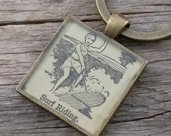 surf riding keychain | woman water skiing / surfing | vintage dictionary image | surfer keychain - SUMMER SALE!