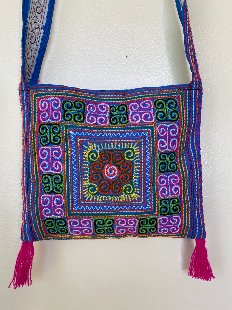 Thai embroidered cross body purse with zipper and fringe pink and blue colorful stitching zipper closure