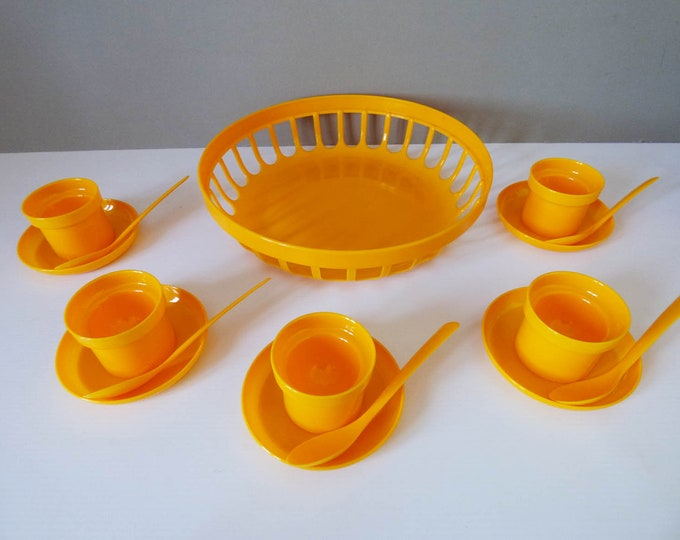 Breakfast set egg cups bowl and spoons.