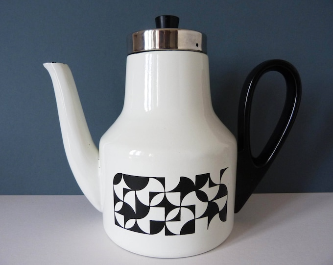 Enamel coffee pot with an Op art pattern.