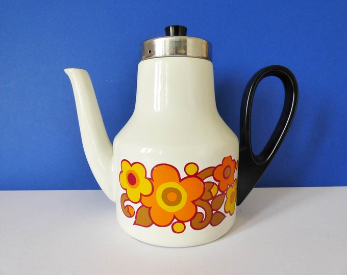 Enamel coffee pot with a daisy pattern.