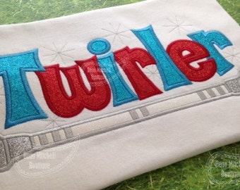 TWIRLER with Baton applique embroidery design