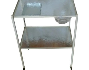 French Industrial Rolling Medical Cart, with two shelves of wavy glass, circa 1930.