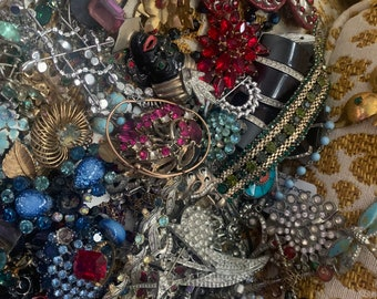 Old Jewelry 1940's thru 1970's. Rhinestones,bracelets, necklaces rings,Brooches, and earrings. A Harvest for old stones and repair work.