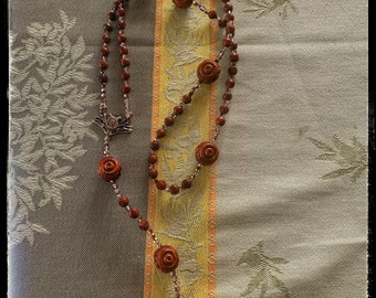 Antique rosary beads - repurposed and re- beaded. French and carved olive wood beads. Czech beads and bronze components- great detail.