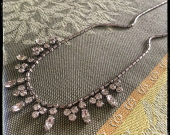 Beautiful Bridal and very vintage necklace. Mint condition, gorgeous faceted stones. Sparkly rhinestones.
