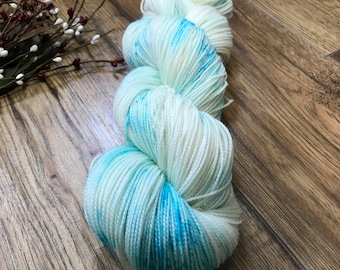 DOLPHIN TEARS, hand dyed yarn 80/20 BFL, superwash Bluefaced Leicester wool nylon fingering, white, blue speckled, aqua, nautical