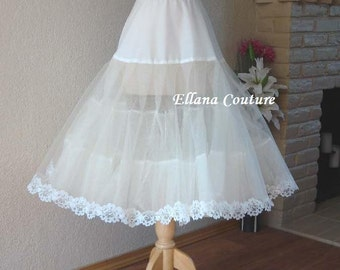 Tea Length Crinoline with Floral Trim. Medium Fullness Petticoat. Available in White, Ivory, or Black