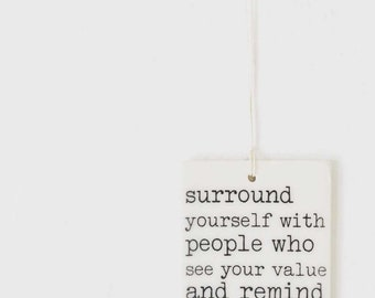 porcelain wall tag screenprinted text surround yourself with people who see your value and remind you of it.