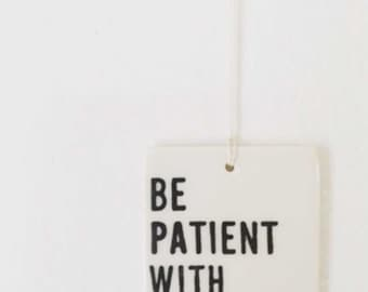 porcelain wall tag screenprinted text be patient with yourself.