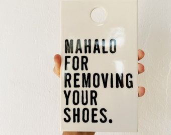 porcelain wall tile screenprinted text mahalo for removing your shoes.