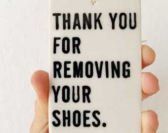 porcelain wall tag screenprinted text thank you for removing your shoes.