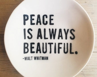porcelain dish screenprinted text peace is always beautiful. -walt whitman