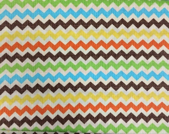Chevrons in Orange, Brown, Yellow, Blue, Green on a Creamy White Background from Timeless Treasures