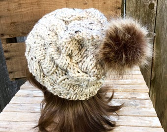 Women s Cable Knit Hat in Oatmeal Tweed with Dark Brown Faux Fur Pom Pom 43533bd6b196