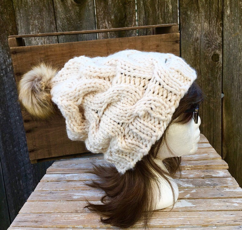 76d9fbcab8a Cream Slouchy Chunky Cable Knit Hat in with Tan Faux Fur Pom