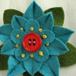 Turquoise Felt Flower Pin with Dark Orange Button and French Knots