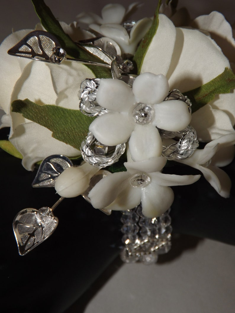 jeweled stephanotis wristlet wedding silver leaf accents prom special event Silver sparkle wrist corsage with cream white petite roses