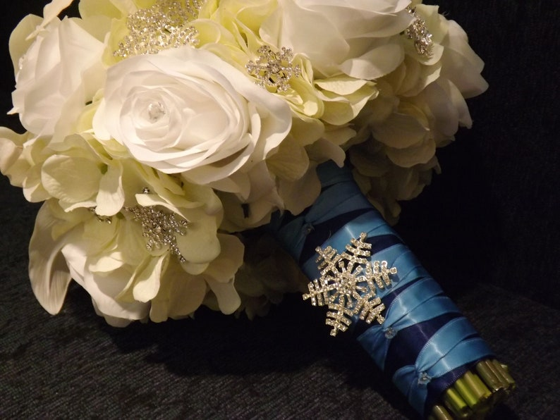 Starburst snowflake crystal brooch bouquet roses and real touch Casablanca lilies creamwhite hydrangea