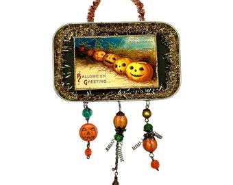 Vintage Halloween Tin Ornament with Jack-o-Lantern Pumpkins