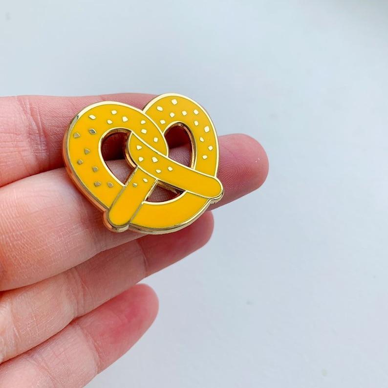 the saltiest pretzel enamel pin image 0