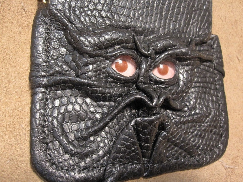 Grichels leather pinch style coin purse scaly black with pink and red albino eyes