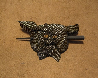 Grichels leather hair thing stick barrette - black with gold stripes with bronze speckled slit pupil reptile eyes