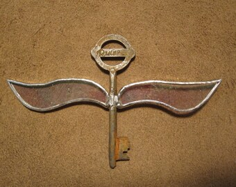 Handmade stained glass winged skeleton key - clear rainbow iridescent glass on large Rule Plus skeleton key