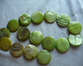 Mother of Pearl, 25mm Round Coin, Light Green with Design. Sold per 16 inch strand. There are 16 beads on the strand.