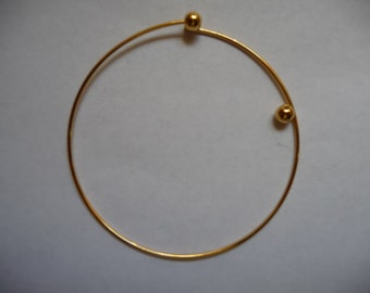 Bracelet, beading bangle, gold-plated brass, 73mm round with 2 screw-on beads, Pack Of 1 bracelet.