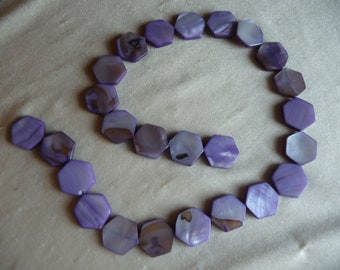Beads, Mother of Pearl, 16mm Hexagon, Shades of Purple.  Sold per 16 inch strand. There are 25 beads on the strand.