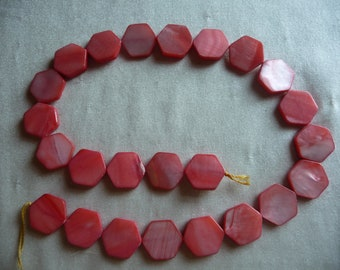 Beads, Mother of Pearl, 16mm Flat Hexagon , Shades of Coral/Red. Sold per 15 inch strand. Total of 24 beads on strand.