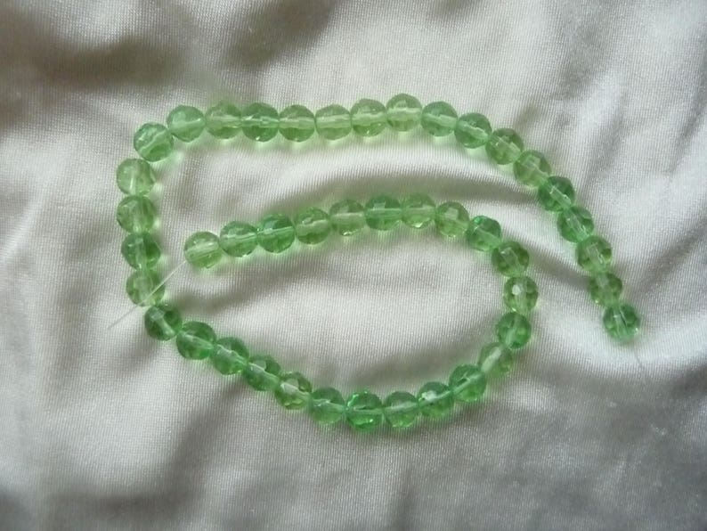 SALE! SALE!! Bead Sold per 12-inch strand glass spring green 7-8mm faceted round