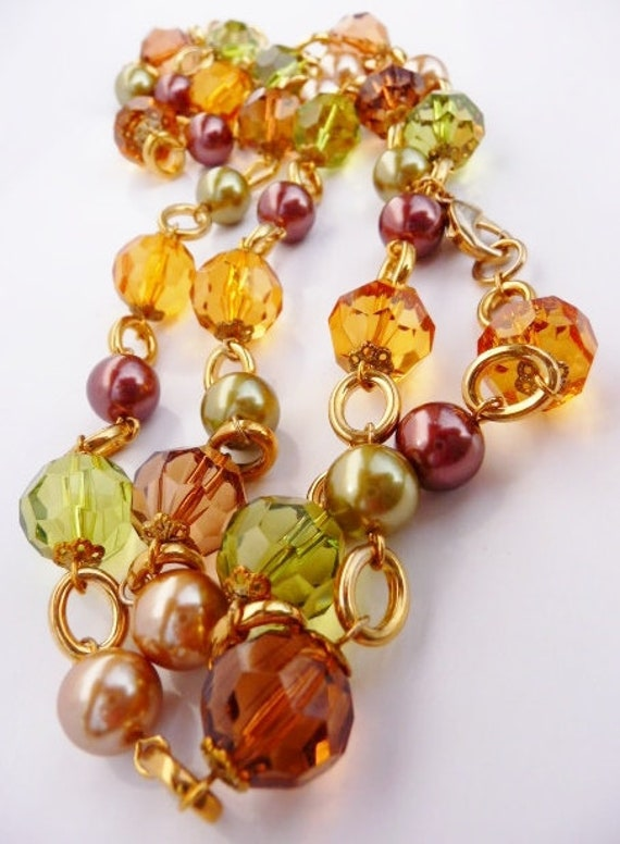 Kenneth Jay Lane faceted lucite bead necklace, amb