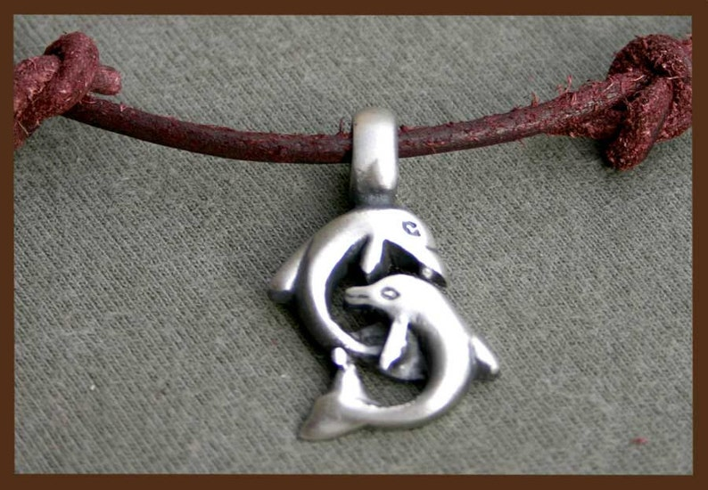 Leather Surfer Necklace With Big Pewter Dolphins Distresed image 0