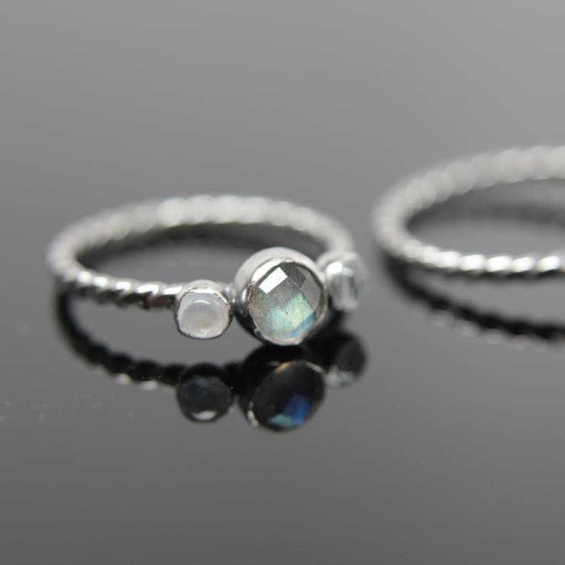 Triple gemstone stacking band. Three gemstones on a textured image 0