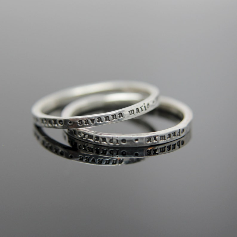 One custom stamped hammered band in sterling silver. Sterling image 0