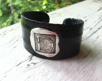snakeskin cuff with pure silver wax stamped initial.